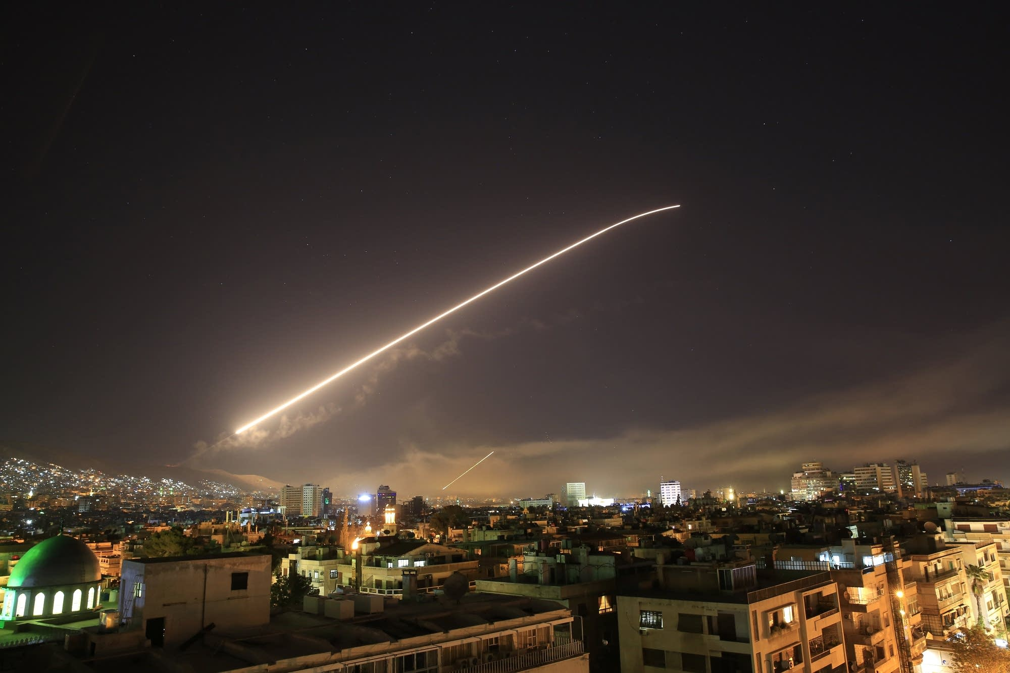 Damascus sky lights up with service to air missile fire