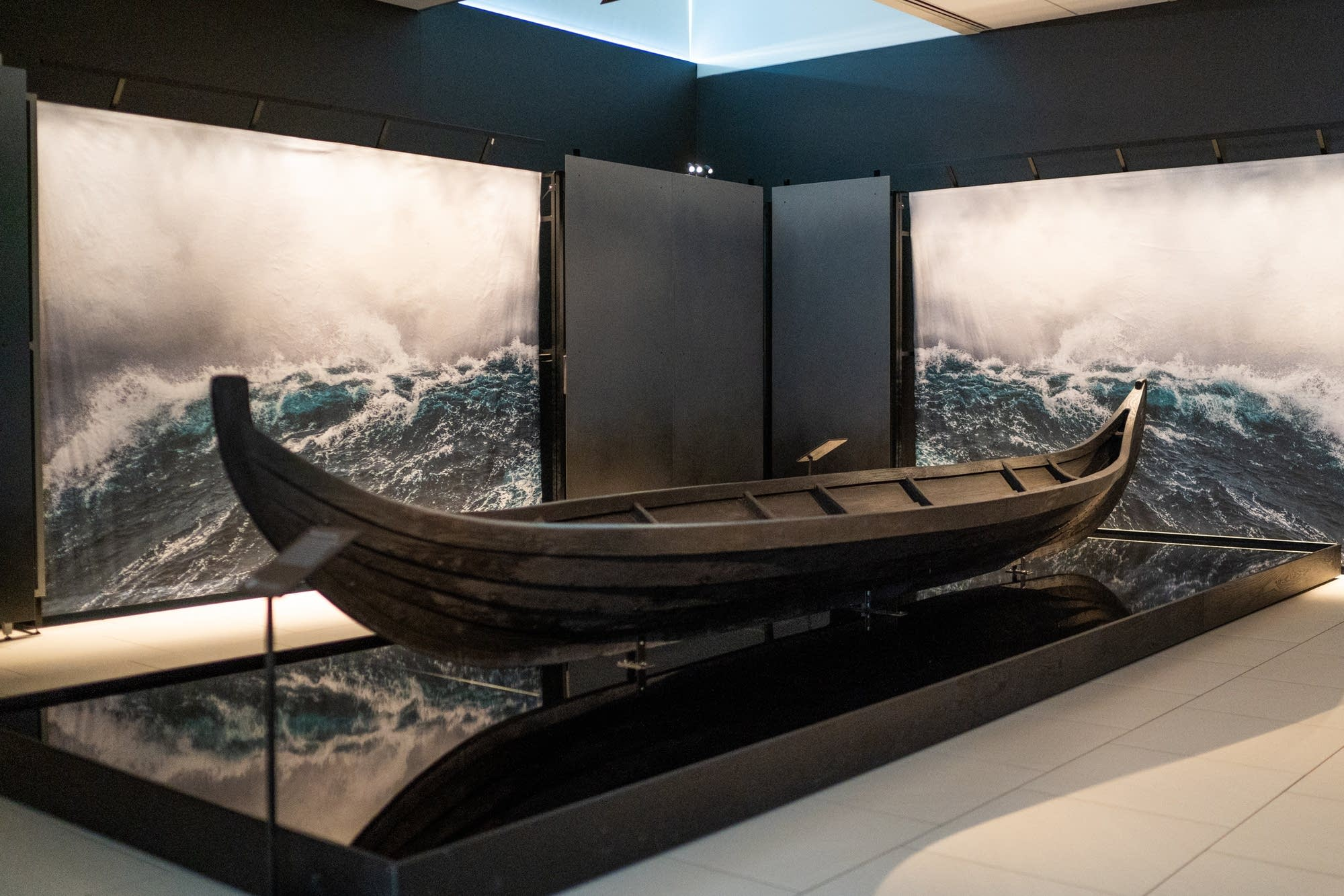 A replica of a Viking burial boat sits on display.