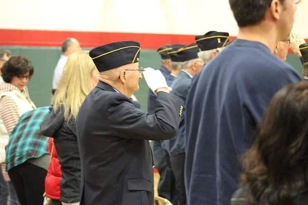 A man in uniform salutes.