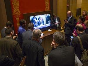 People gather to watch the Senate debate a bill.