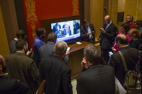 People gather to watch the Senate debate a bill.