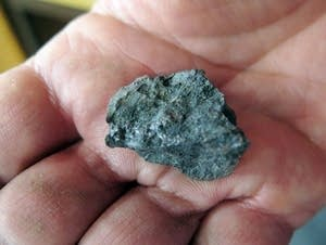 A small piece of ilmenite ore
