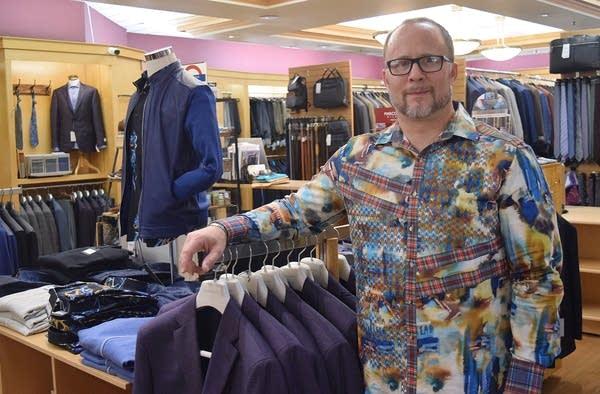 Svaar Vinje stands in his downtown clothing shop.