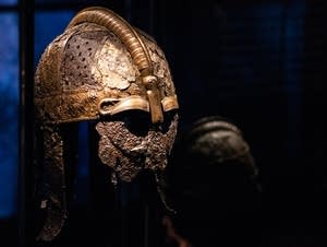 A Viking battle helmet sits on display.