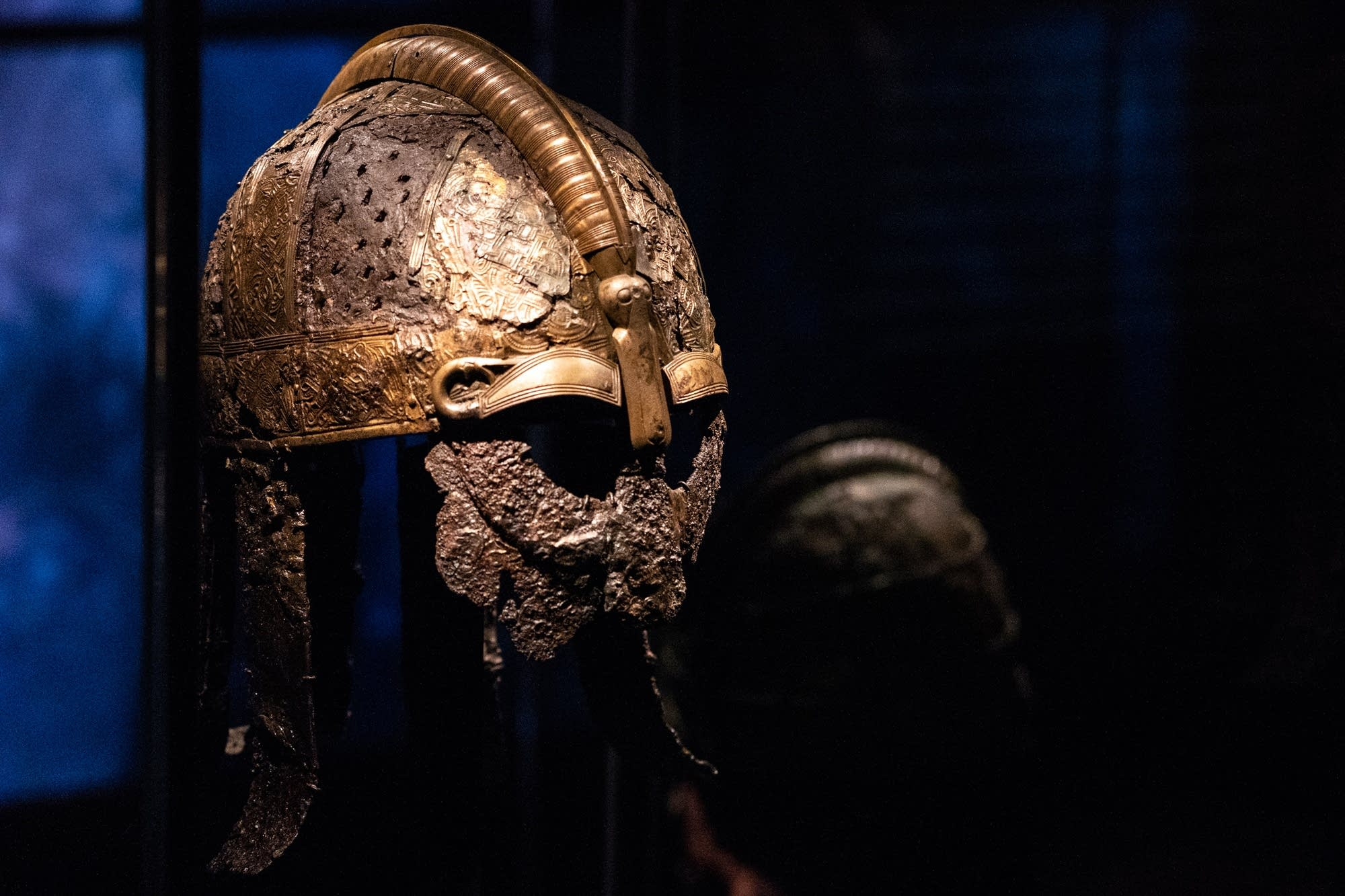 A Viking battle helmet sits on display.