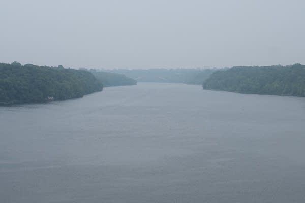 A hazy sky over a river.
