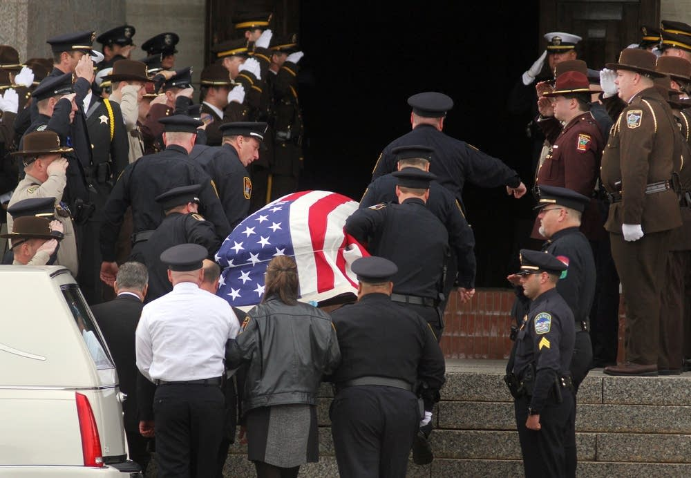 Casket carried into church