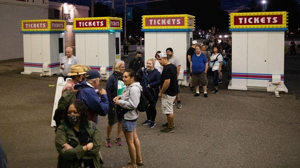 People line up at the gate of the Minnesota State Fair.