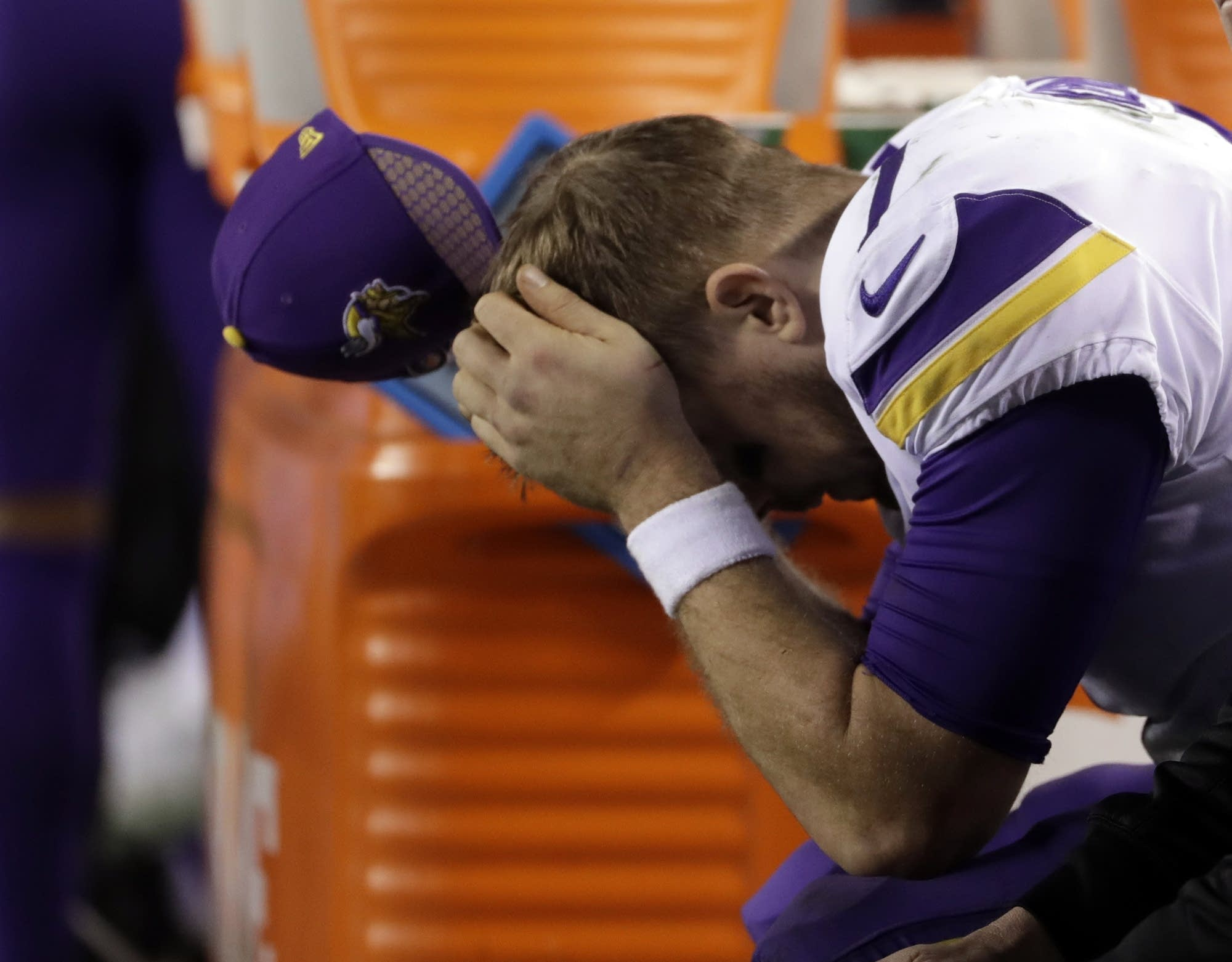 Vikings' Case Keenum reacts on the bench.