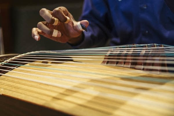 Jarrelle Barton uses finger picks to play the Guzheng,