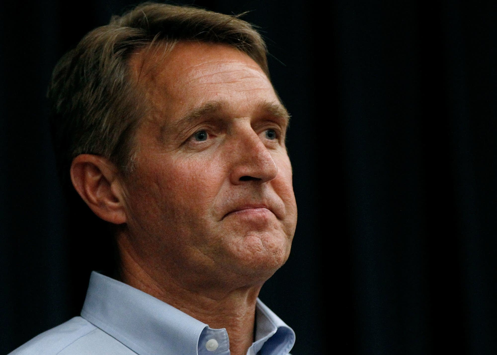 Arizona's Flake, in New Hampshire, mulls 2020 challenge to Trump