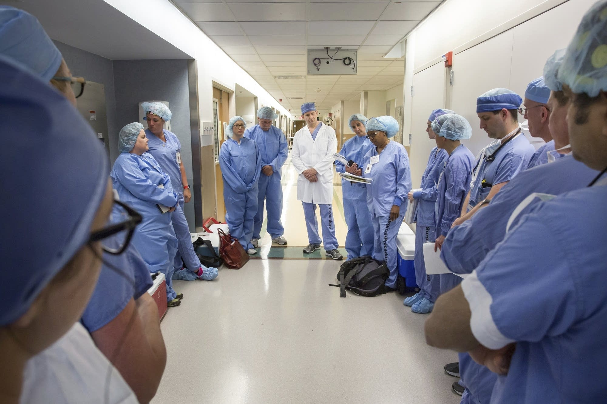 Doctors and nurses at gather before performing a face transplant