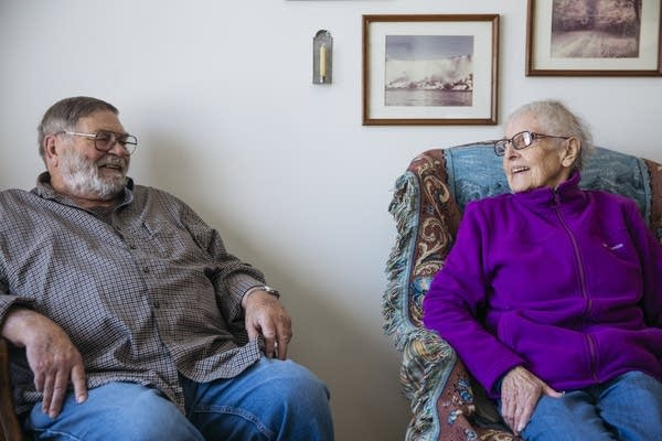 Don and Elaine Lange sit in their living room.