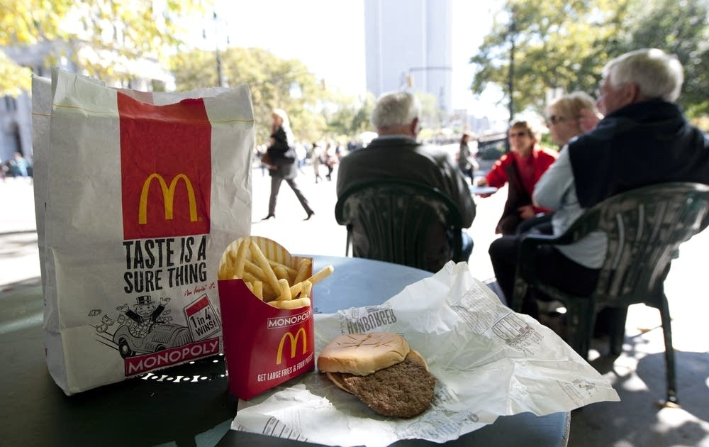 A McDonald's hamburger and fries on a table
