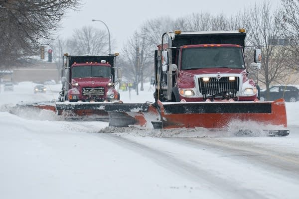 Two City of Mankato snowplows clear a road