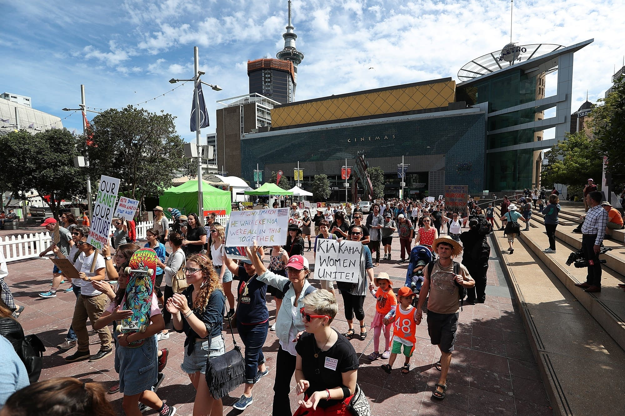 Auckland, New Zealand: Thousands of people march up Queen Street.