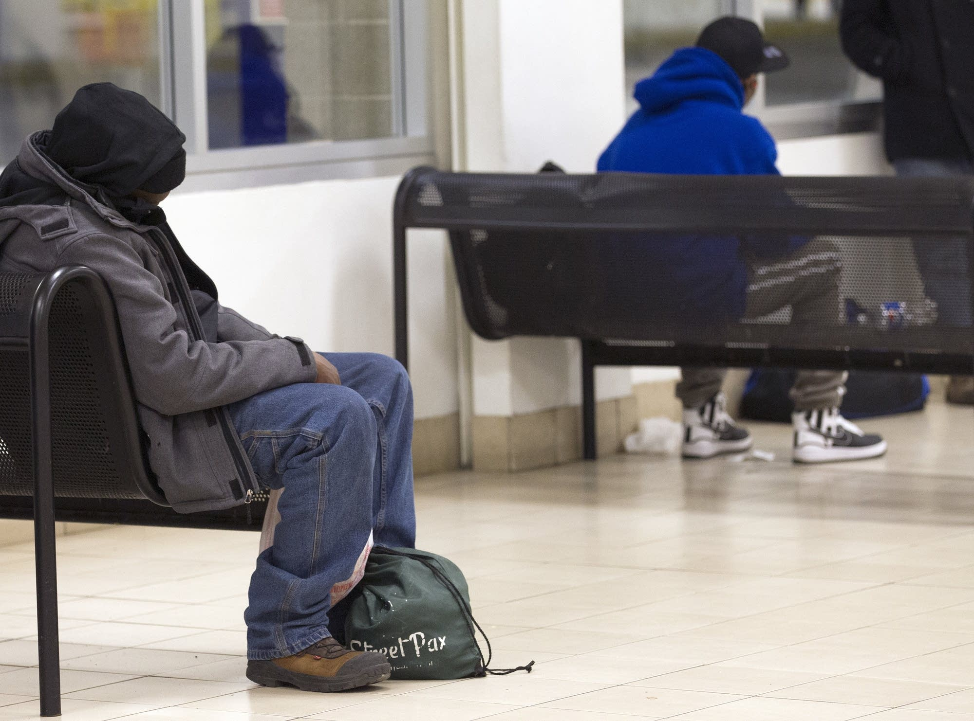 Many wait at light rail stations and board trains as a place to sleep.