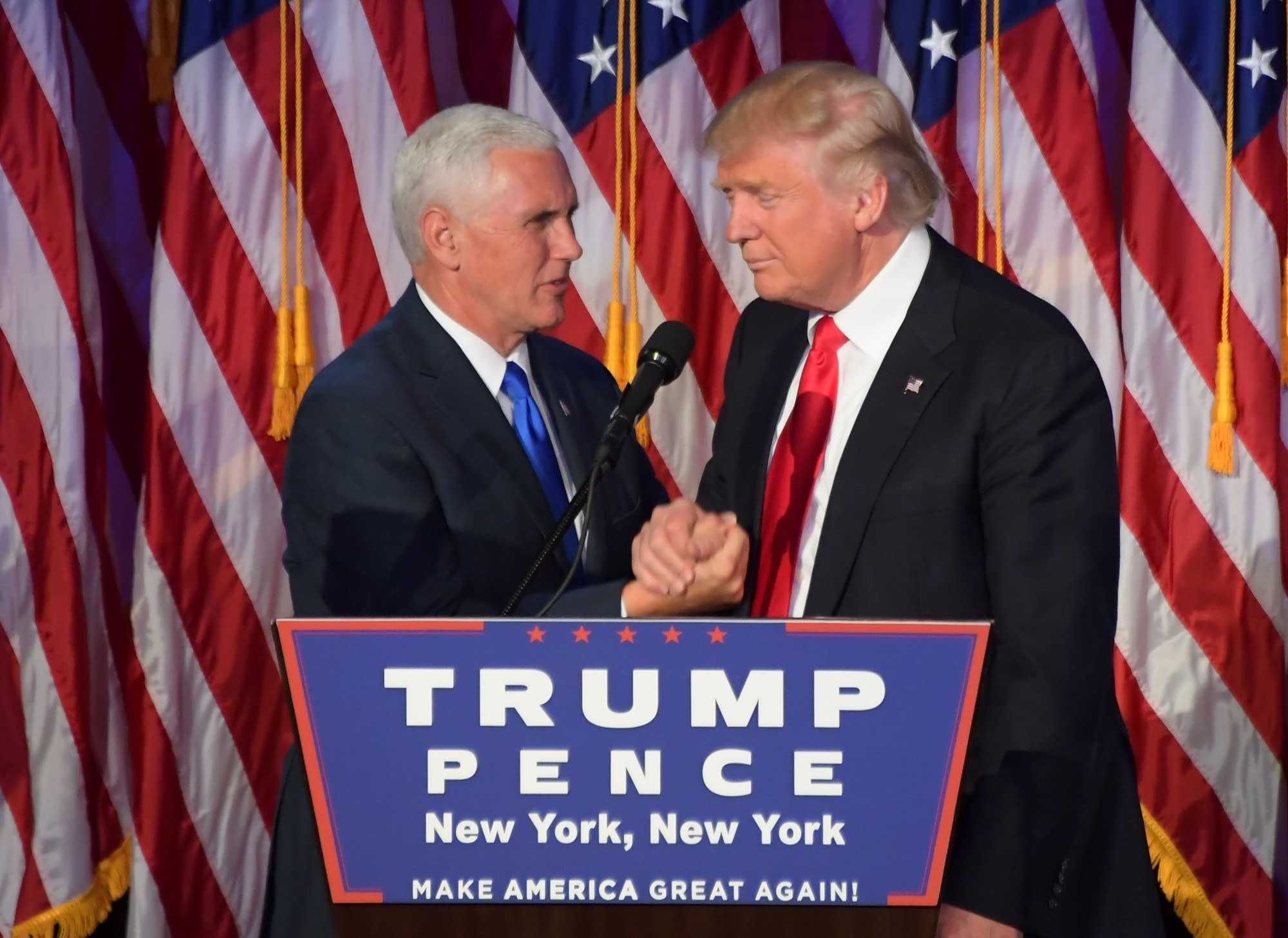 Pres. elect Donald Trump shakes hands Mike Pence.