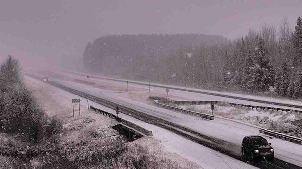 An early-season snowfall coats a stretch of U.S. Highway 53