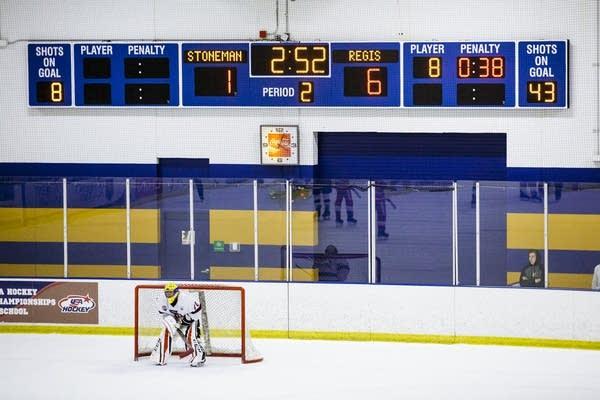 The Stoneman Douglas High School goalie hangs out in the net.
