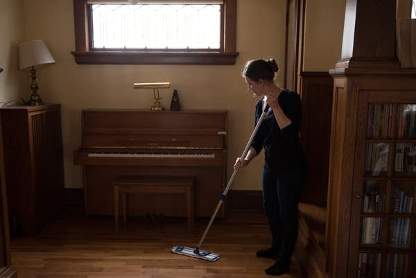 Artist Katy Collier cleans at client's home.