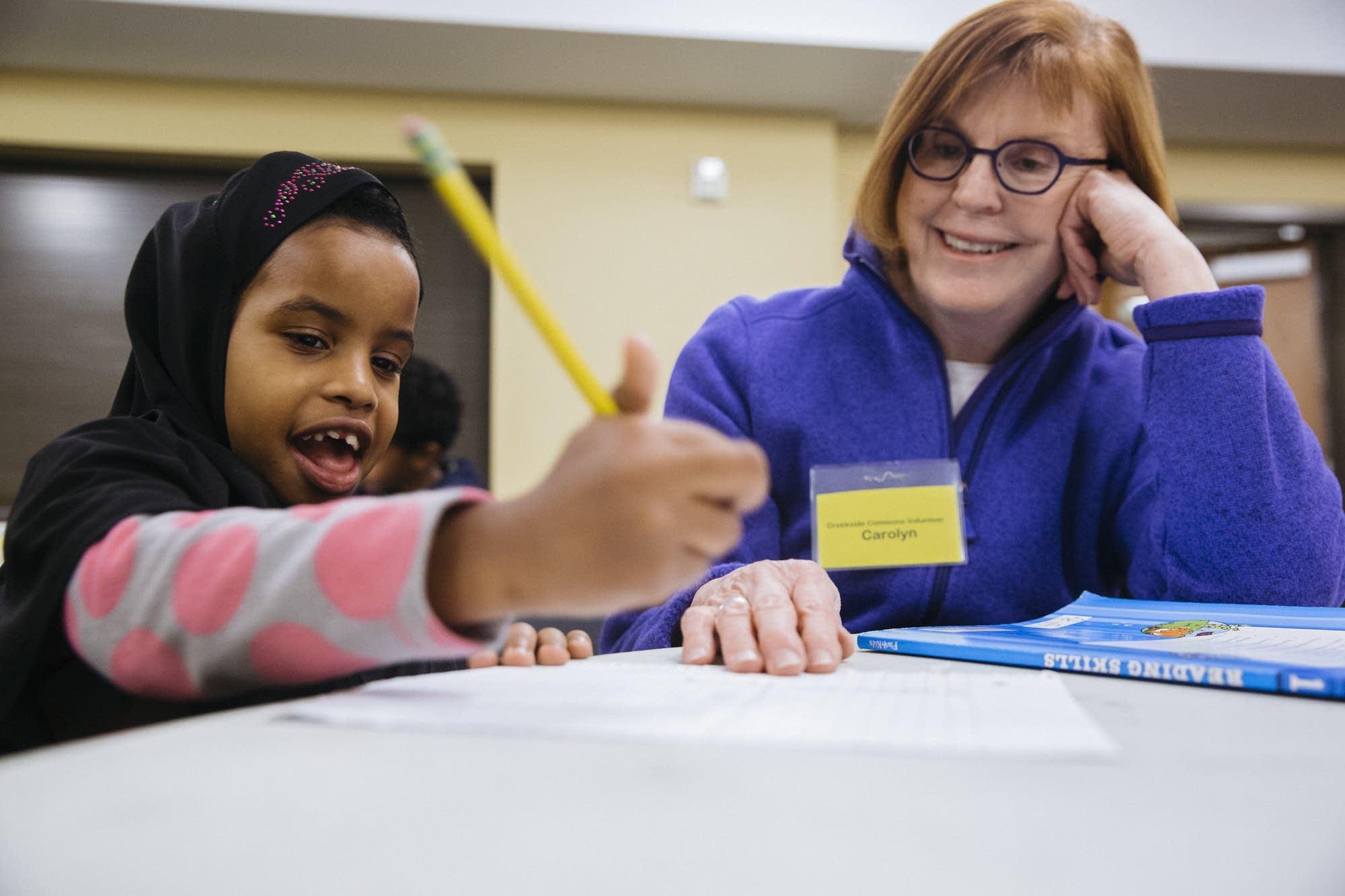 First-grader Nafisa gets homework help.