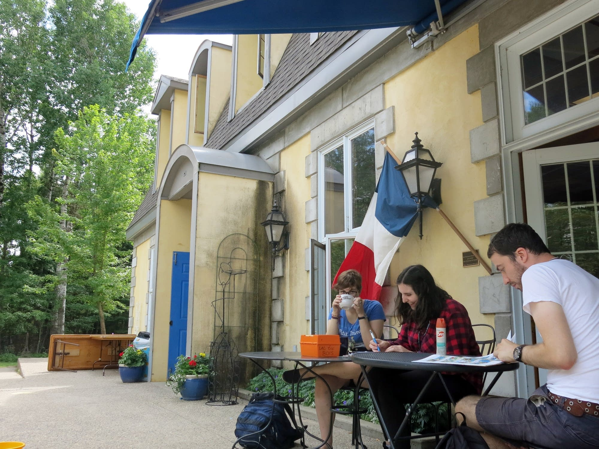 Students study outside at the French village.