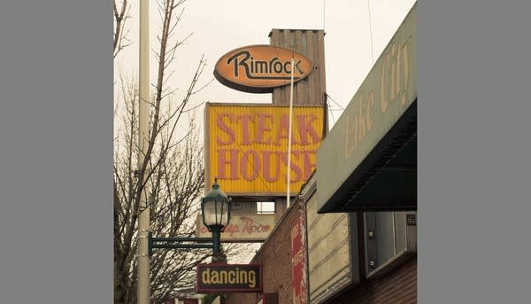 Signs outside old Rimrock Steakhouse in Seattle