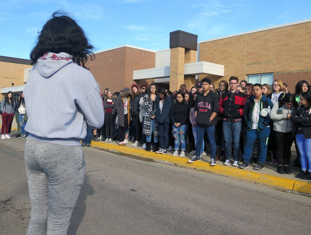 Students walk out of Worthington High School.
