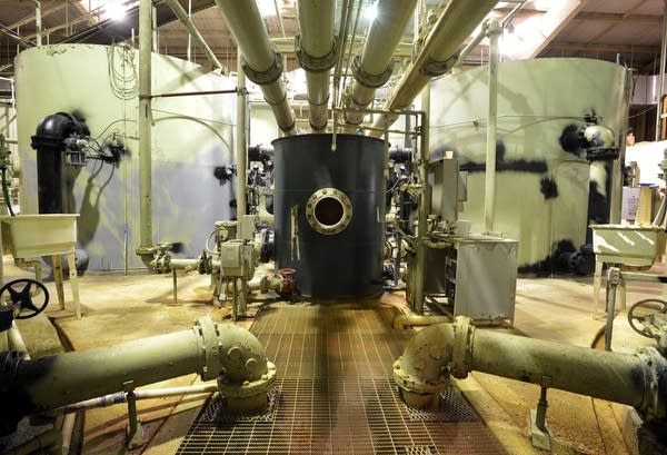 Water runs through sand filtration tanks and connecting pipes.
