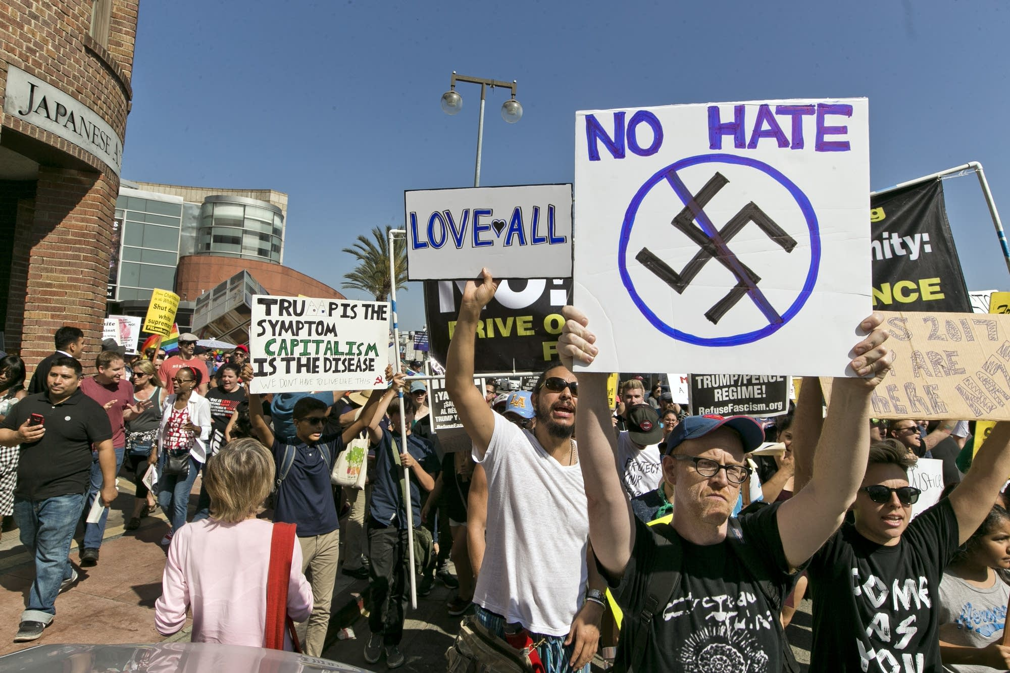 Demonstrators march in downtown Los Angeles.