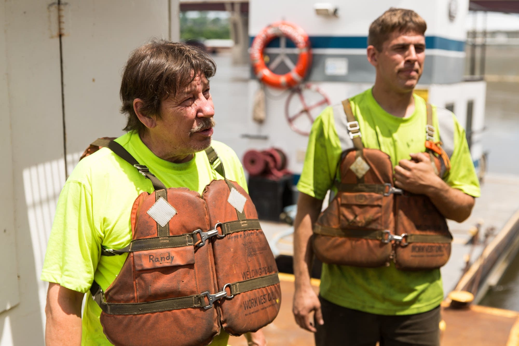 Randy Kohl and Ben Brooks stand on the vessel used in Thursday's rescue.