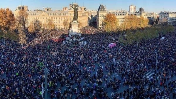 People gather on the Place de La Republique in Paris