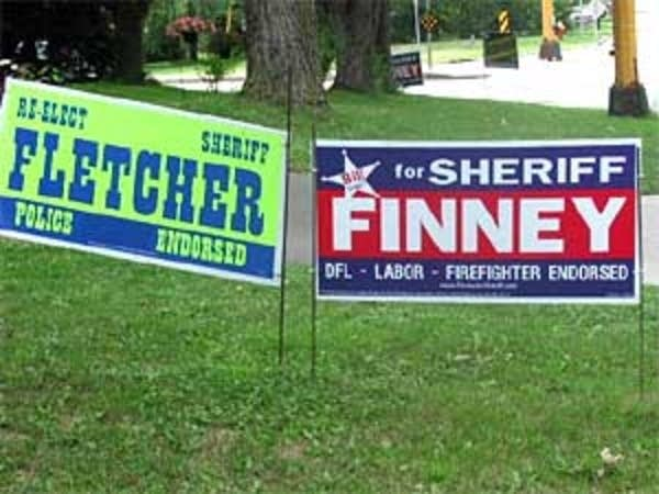 Dueling lawn signs