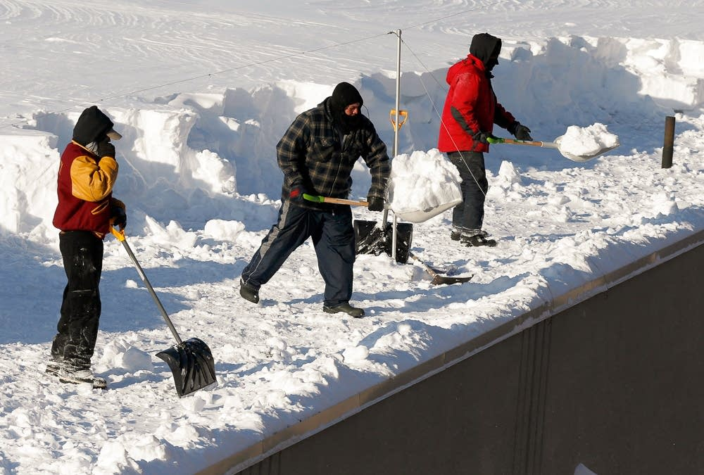 Clearing snow off a roof in Boston