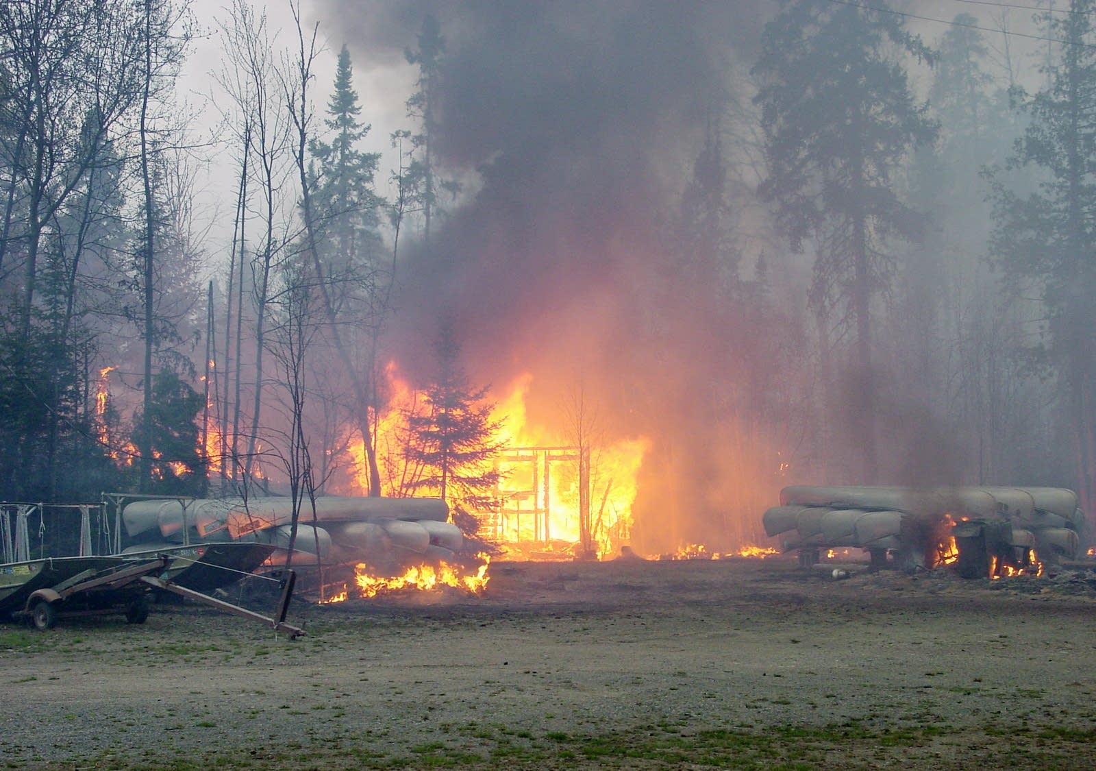 An outfitter is a complete loss before firefighters could save it.