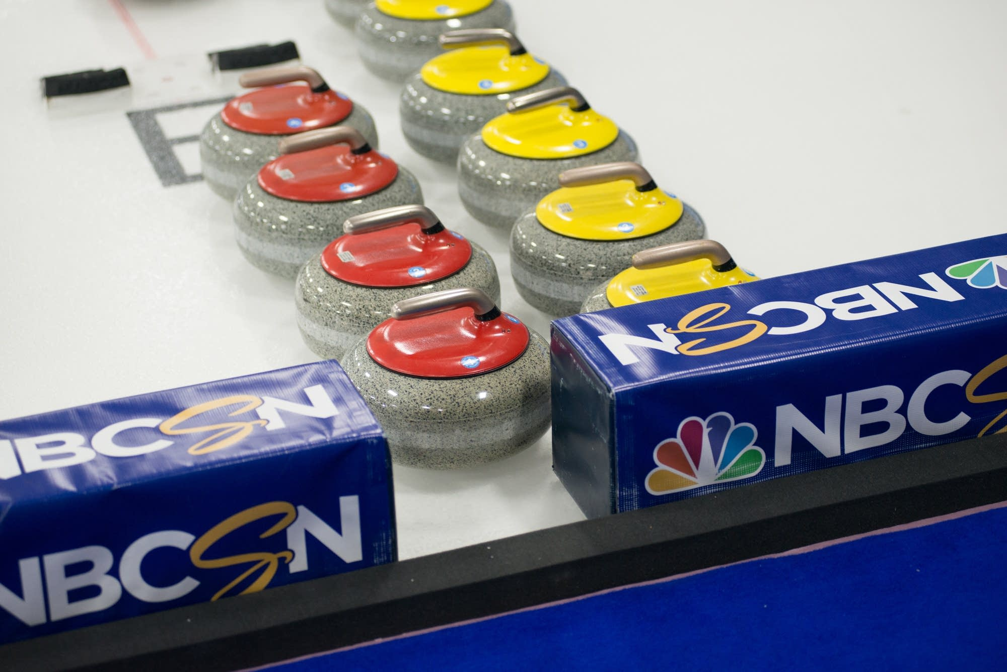 Extra curling stones are on standby during the Olympic trials.