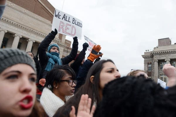 """Protesters chant """"hands up don't shoot."""""""