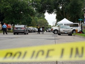 Investigators are at the scene of a shooting that injured a police officer.