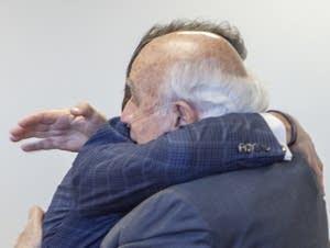 Robert Murray of Murray Energy, right, hugs Energy Secretary Rick Perry.