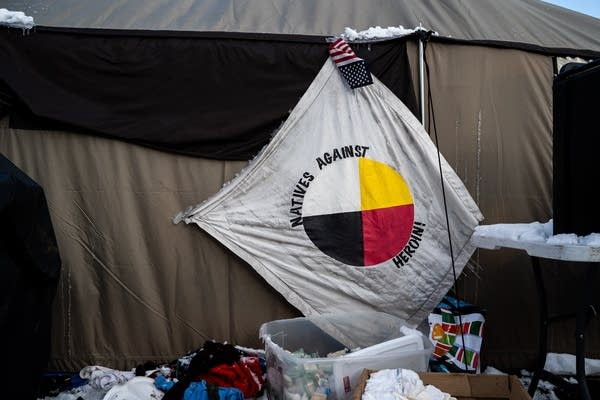 A Natives Against Heroin flags hangs frozen.