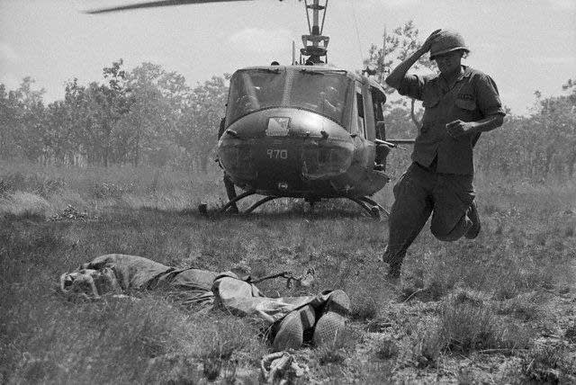 Soldier Picking Up  Body In Vietnam