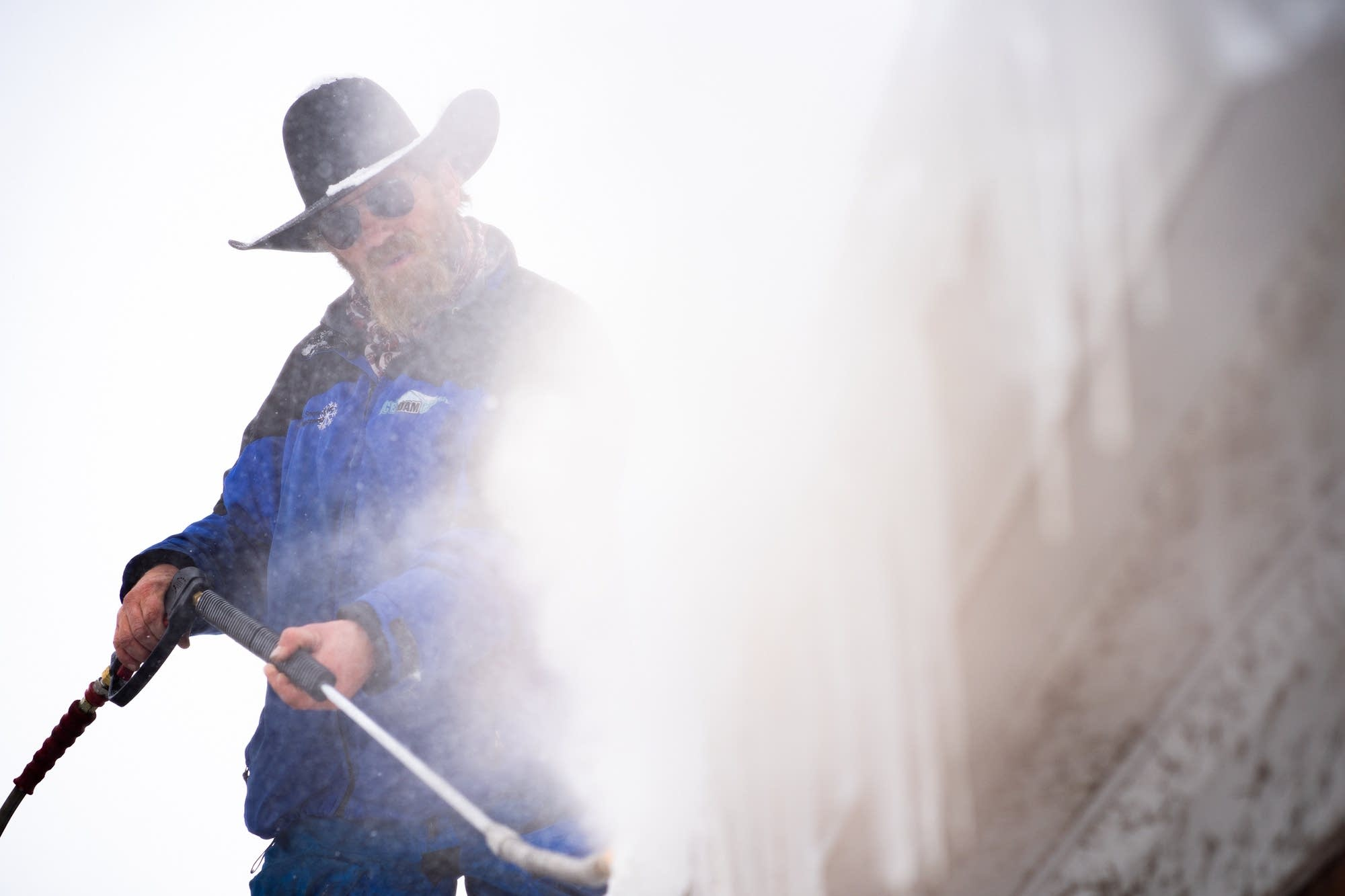 Ice Dam Guys technician Jake Weber uses pressurized steam.