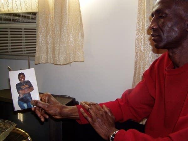 man holding photo of girl 2