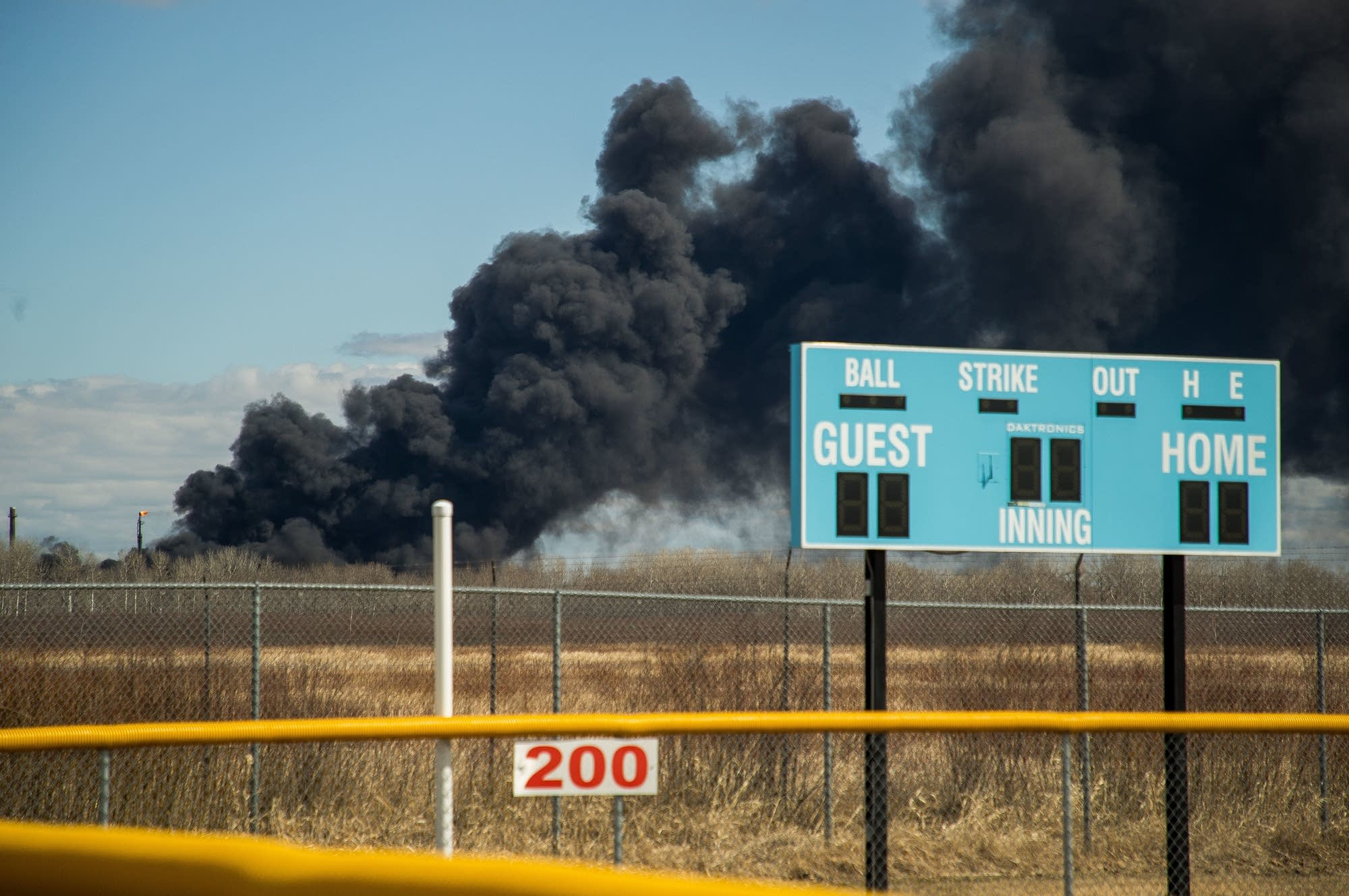 Black smoke rises behind Superior Middle School.