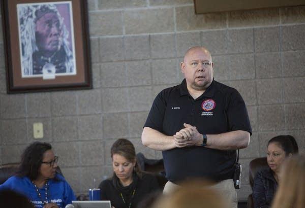 Emergency management coordinator Schyler Martin provides flood updates.