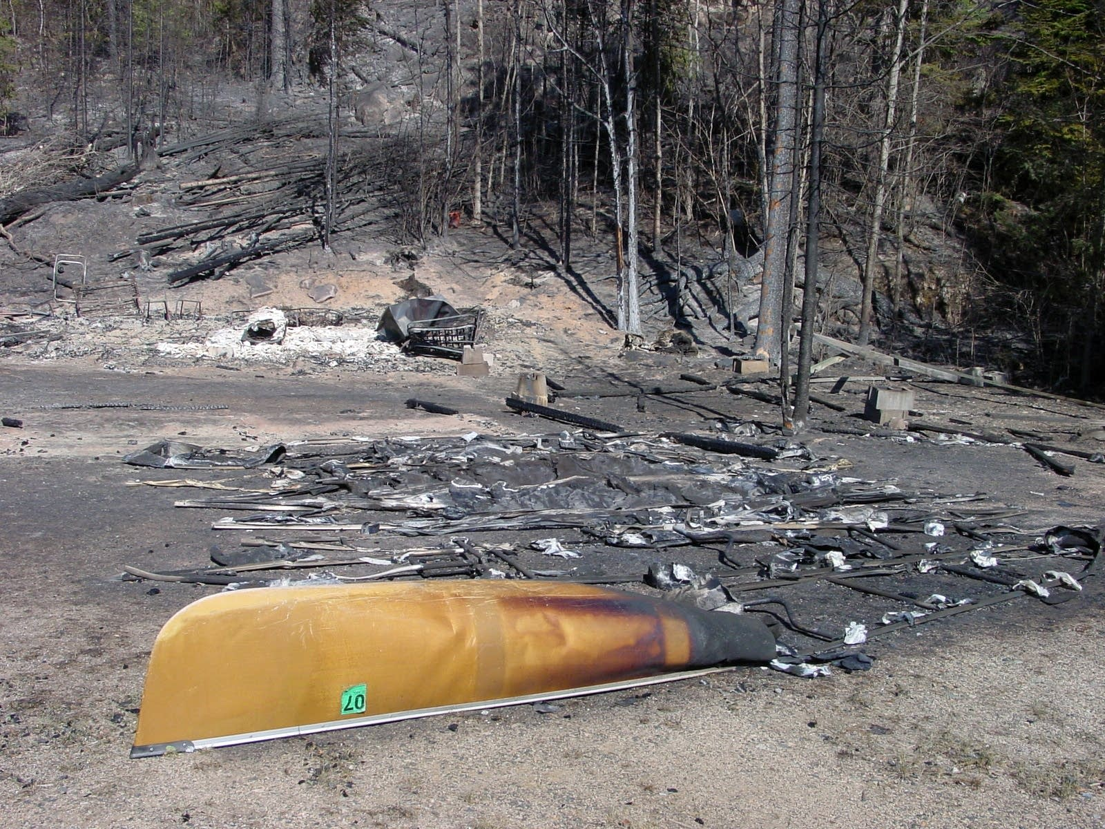 An outfitter's canoes were turned into puddles of aluminum by the fire.