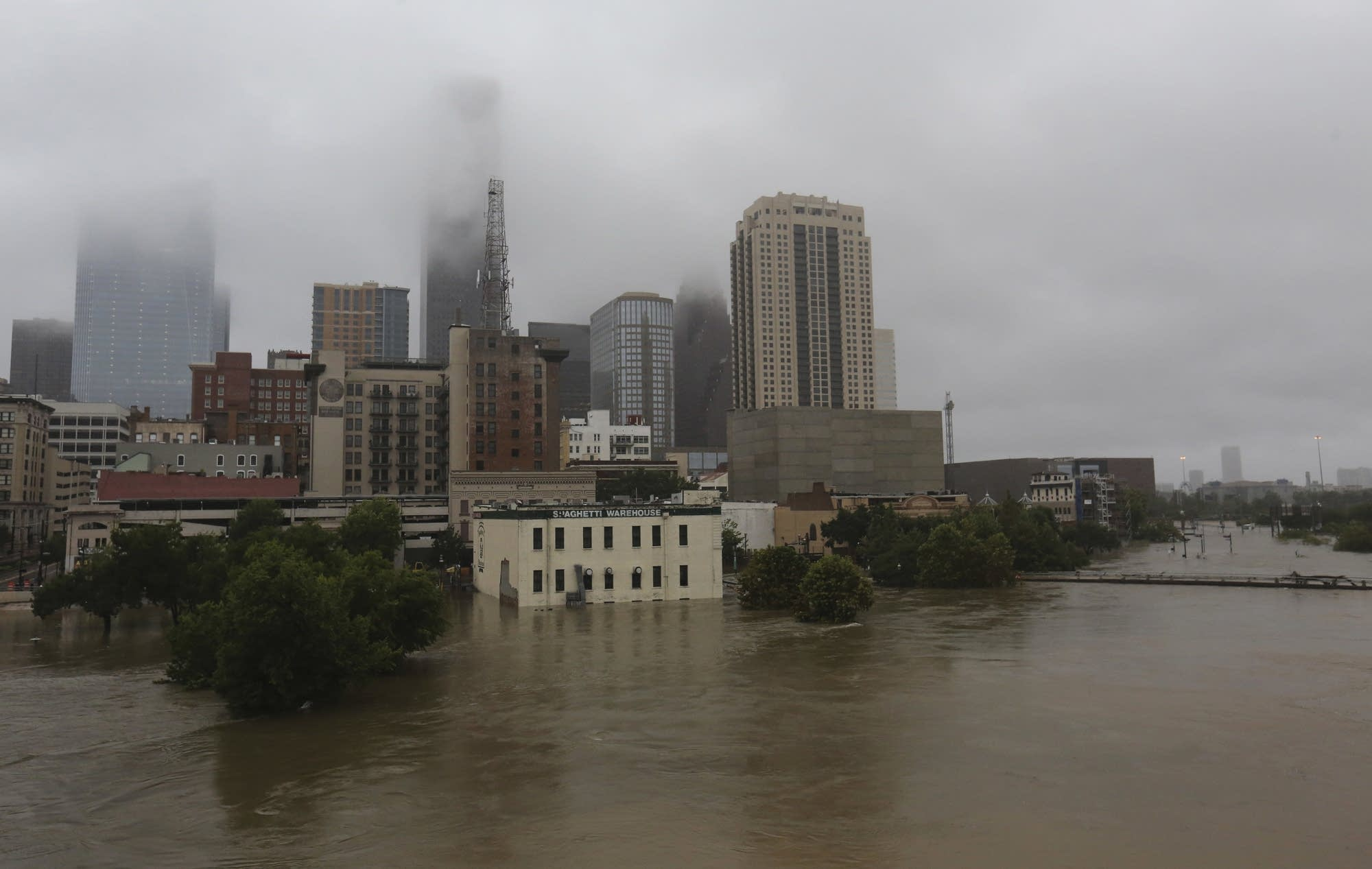 Floodwaters from Tropical Storm Harvey flow in the Buffalo Bayou.