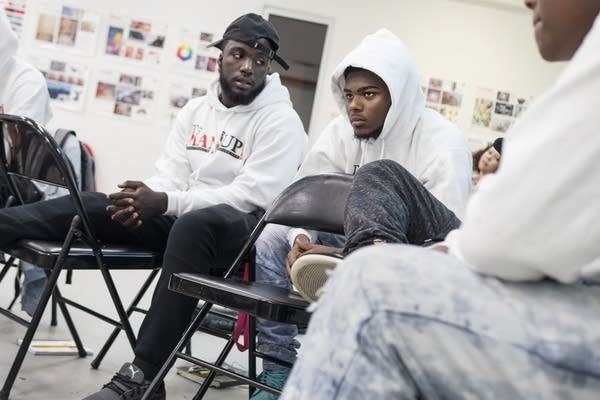 Meek Stalling, 17, left, listens as Keimonte White, 16, shares challenges.