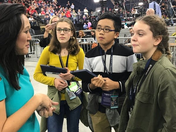 Students interview a woman.